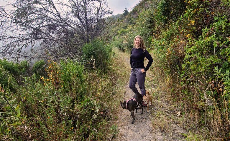 Jennifer Robinson hiking with dogs
